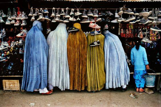 Afghan women at shoe store', 1992. | 24 Striking Pictures Of Afghanistan By Photojournalist Steve McCurry- Balkan War was raging on